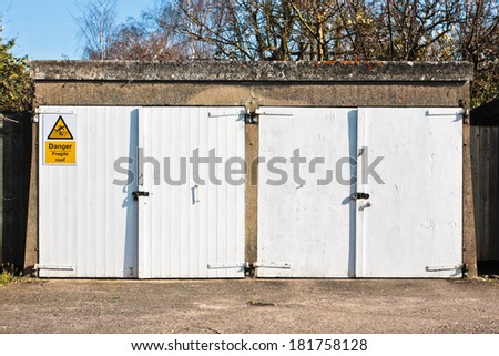 A pair of white wooden garage doors - stock photo