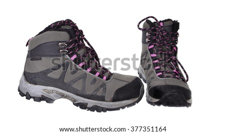A pair of winter  hiking boots. Isolated on white - stock photo