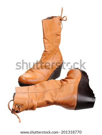 A pair of women boots, isolated on white background - stock photo