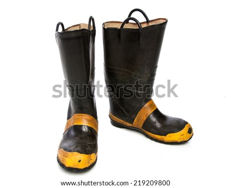 A Pair of Worn Fire Boots Isolated on White Background