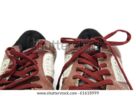 a pair of worn sneakers isolated on a white background