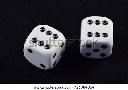 A pair white of dice showing Double six