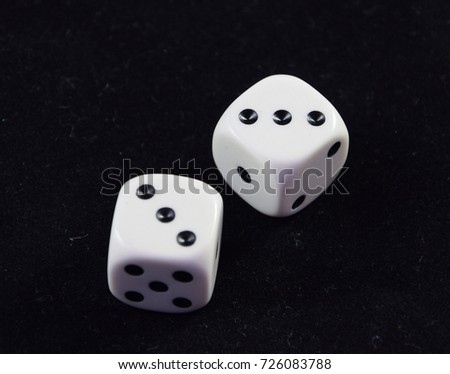 A pair white of dice showing Double Three