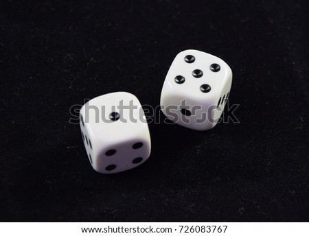 A pair white of dice showing Five and One