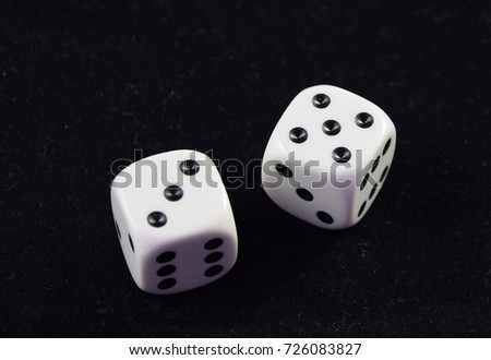 A pair white of dice showing Five and Three