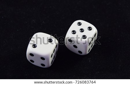 A pair white of dice showing Five and Two