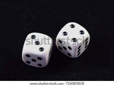 A pair white of dice showing Four and Three