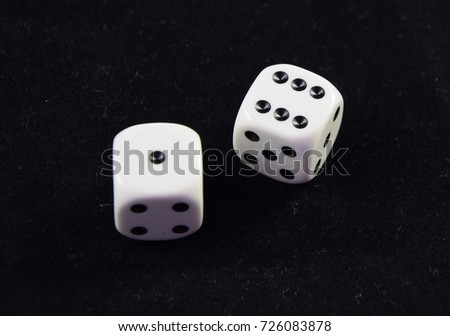A pair white of dice showing Six and one