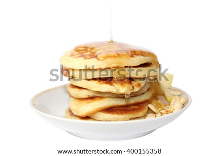 A pancake is a flat cake, often thin, and round, prepared from a starch-based batter that may also contain eggs, milk and butter and cooked on a hot surface such as a griddle or frying pan. - stock photo