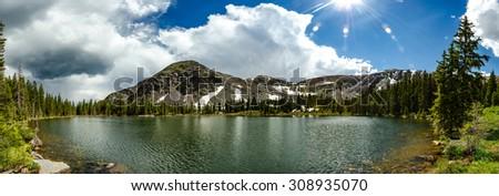 A panorama of a cold mountain lake near Gunnison, Colorado - stock photo