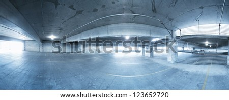 a panorama of a parking garage - stock photo