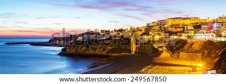 A panorama of Albufeira in the dusk in Algarve region, Portugal, Europe - stock photo