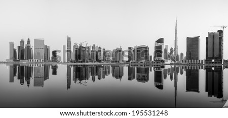A panorama of Business Bay, taken just after sunrise when the wind and water was still calm. - stock photo