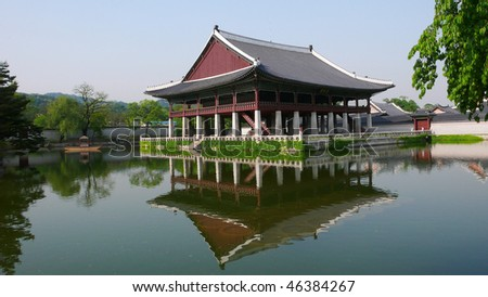 A panorama of Gyeonghoeru, a 15th-century, 2-story, open pavilion used for royal banquets. It is surrounded by a square reflecting pool, with Inwangsan (Mt Inwang) in the background - stock photo