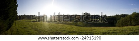 a panorama of the lush green countryside