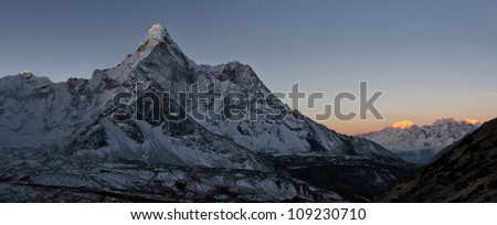 A panorama of the wall Ama Dablam early in the morning - Everest region, Nepal, Himalayas - stock photo