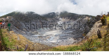 A panorama view of Kawah Ratu which is the biggest volcanic crater on Mount Tangkuban Perahu, Bandung, West Java, Indonesia. The crater is also known Queen of the Craters. - stock photo