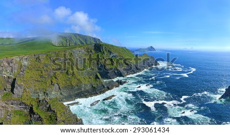 A panoramic and stunning view of the Kerry Cliffs, the Skelligs and Penguin Island can be seen in the distance, The Ring of Kerry, Ireland - stock photo