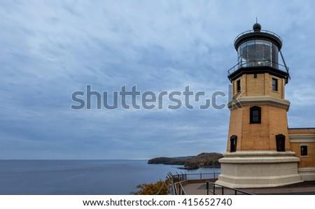 A Panoramic Autumn Dusk Shot of the Split Rock Lighthouse Guarding Over Lake Superior - stock photo
