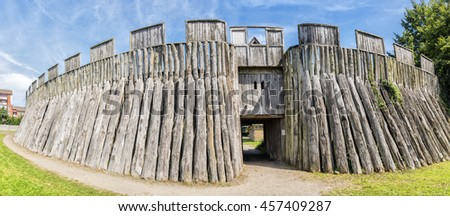 A panoramic image of a reconstructed wooden viking fort called a trelleborg in the swedish city of the same name.