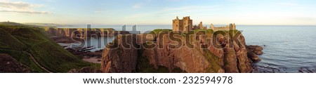 A panoramic image of Dunnotter Castle perched on a cliff off the east coast of Scotland. - stock photo