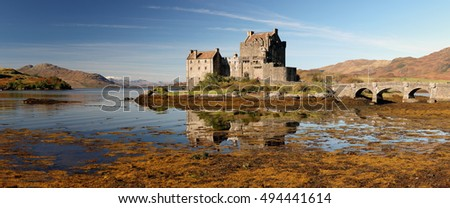 A panoramic image of Eilean Donan Castle reflecting on Loch Duich, Dornie, Skye and Lochalsh.