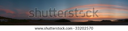 A panoramic image of the swedish coastline near Torekov at sunset.