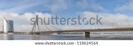 A panoramic image of the Vansu bridge that spans the river Daugava in the Latvian capital of Riga. - stock photo