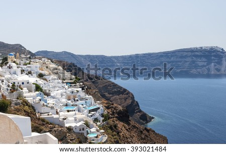 A panoramic stitch of Oia, Santorini island in Greece. - stock photo