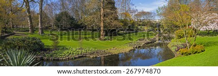A panoramic view of a little waterfall and river in Hyde Park in London.