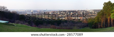 A panoramic view of Belgrade from the summer ski slope in Kosutnjak forest - stock photo