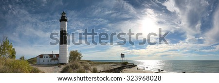 A panoramic view of Big Sable Point Lighthouse late in the day and in the fall season - Ludington, Michigan  - stock photo