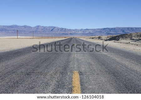 A panoramic view of CA 190 E and Inyo Mountains - stock photo