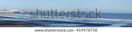 A panoramic view of Hartlepool bay showing pools of water on the sand at low tide in the foreground. North of England - stock photo