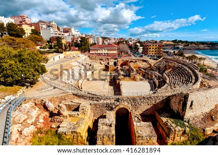 a panoramic view of the ancient roman amphitheater of Tarragona, Spain, next to the Mediterranean sea - stock photo