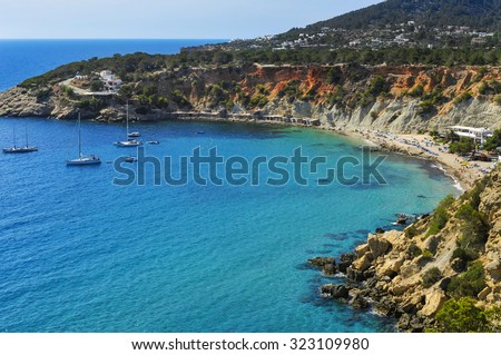 a panoramic view of the Cala de Hort cove in Ibiza Island, Spain, and its traditional fishermen shelters - stock photo