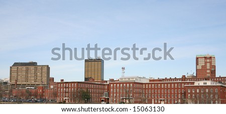 A panoramic view of the downtown Manchester, NH skyline. - stock photo