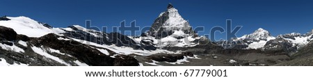 a panoramic view of the mountain Matterhorn in the Swiss alps