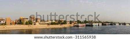 a panoramic view of the Nile River with the Kom Ombo temple at the background, Egypt - stock photo