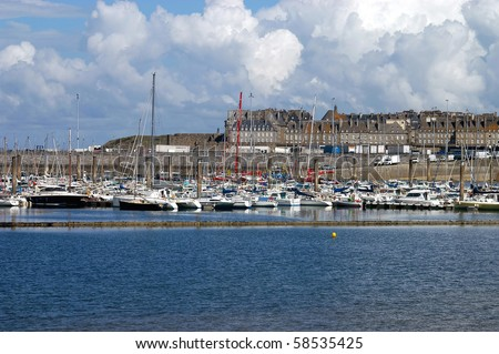 A panoramic view of the port of St Malo with the city walls behind - stock photo