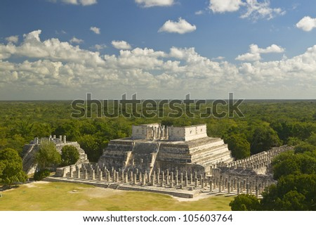 A panoramic view of the Temple of the Warriors out of jungle at Chichen-Itza. A Mayan ruin, in the Yucatan Peninsula, Mexico - stock photo