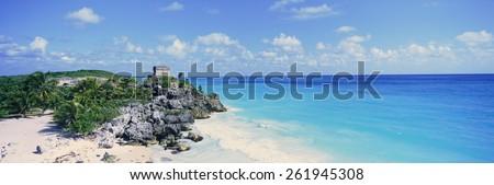 A panoramic view of the Templo del Dios del Viento Mayan ruins of Ruinas de Tulum (Tulum Ruins) in Quintana Roo, Yucatan Peninsula, Mexico - stock photo
