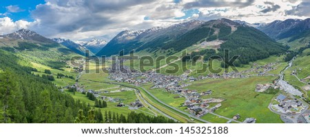 a panoramic view of valley city Livigno in Italian Alps