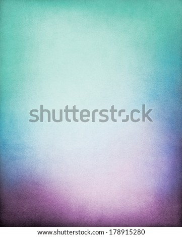 A paper background with a purple to green color gradient and a glowing center.  Image displays a strong paper grain and texture at 100 percent. - stock photo