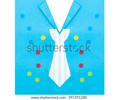 A paper card with shirt, tie and colorful decoration - stock photo