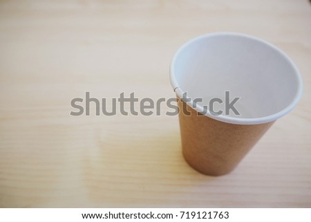 a paper cup on a table