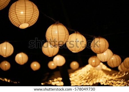 A Paper Lantern Floats On Dark Back Ground Wedding Day