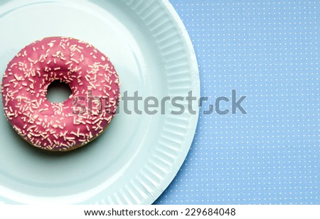 a paper party plate with a doughnut  - stock photo