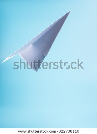 A paper plane in the sky - stock photo