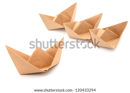 A paper ships in leadership - stock photo
